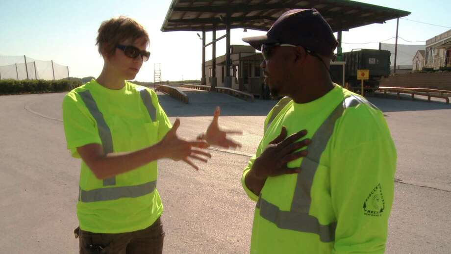 "Austin choreographer Allison Orr instructs a garbage worker in the documentary ""Trash Dance."""