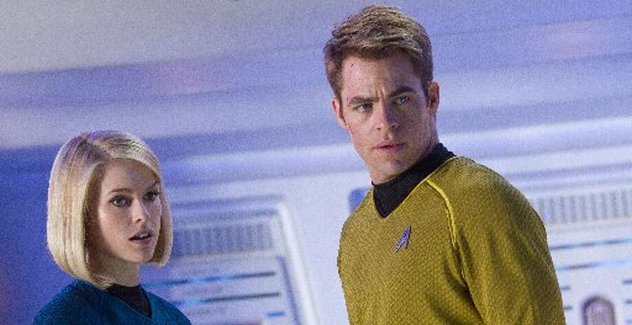 "The latest Star Trek film, ""Star Trek:Into Darkness"", is produced and directed by J.J. Abrams."