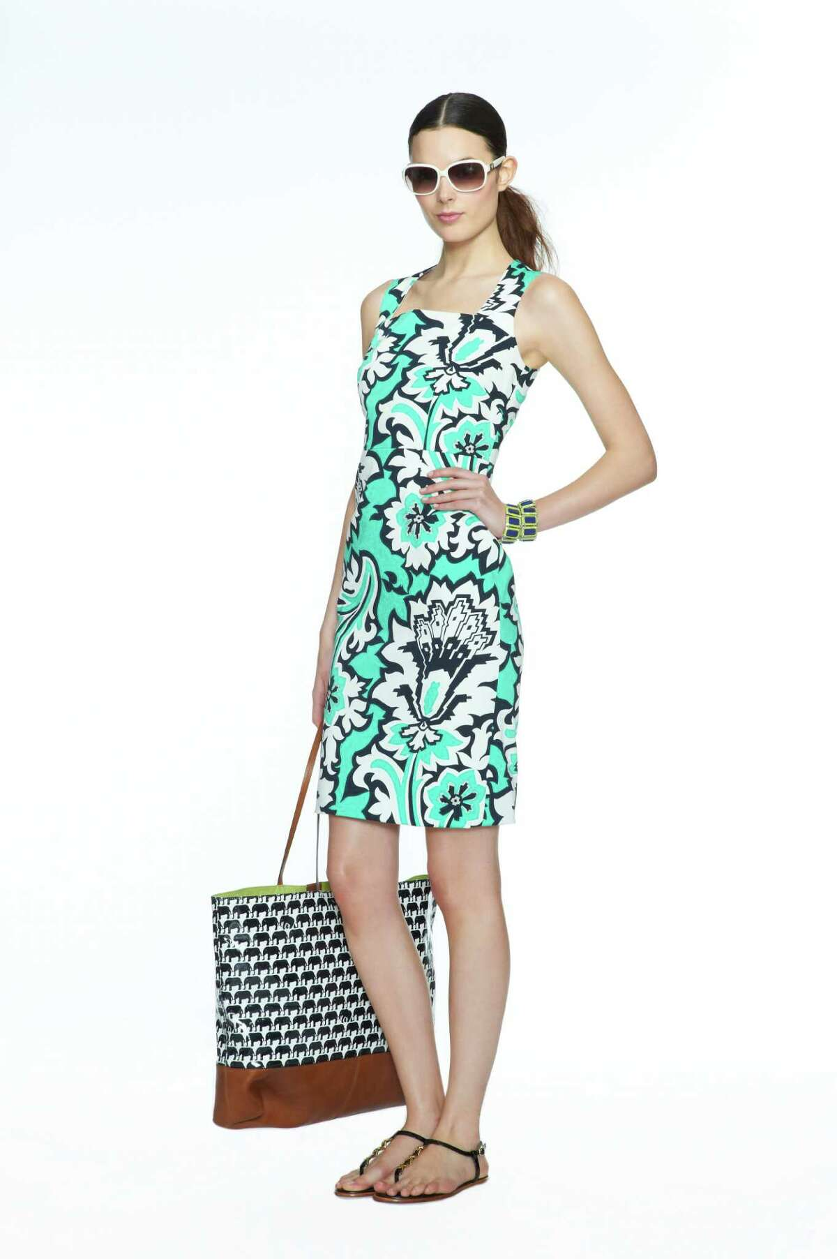 style: Banana Republic Milly Collection includes this Pool Green Eden Rock Printed Dress, $130, Ivory Madeline Sunglasses, $98; Lime/Navy Two-Tone Stretch Bracelet, $35 each; Navy/White Elephant Print Tote, $130; Black Patent Leather Sandal, $89; all at Banana Republic stores and online.