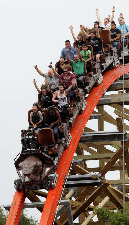 People enjoy the 171 foot drop on the new Iron Rattler roller coaster Wednesday May 15, 2013 during a media day event to introduce the ride at Six Flags Fiesta Texas. Photo: JOHN DAVENPORT, SAN ANTONIO EXPRESS-NEWS / ©San Antonio Express-News/Photo may be sold to the public