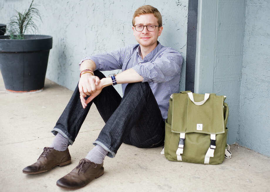 Oliver Shuttlesworth, founder of Esperos, wears one of his backpaks in Austin, TX on Wed., April 24, 2013.  Through selling Esperos backpacks, tote bags and other items, Shuttlesworth and his team have been able to help provide access to education for impoverished children in developing countries. Ashley Landis/Contributor Photo: Ashley Landis, Contributor / copyright 2013 Ashley Landis