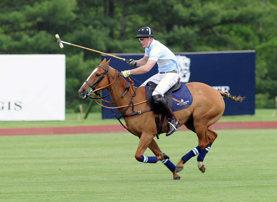 Prince Harry in action during the Sentebale Royal Salute Polo Cup match at the Greenwich Polo Club, Wednesday, May 15, 2013. The polo match was played to raise funds for Sentebale, a charity Prince Harry co-founded in 2006 in memory of his late mother, Princess Diana. Photo: Bob Luckey / Greenwich Time