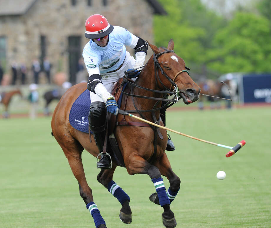 Malcolm Borwick, captain of the Sentebale team, in action during the Sentebale Royal Salute Polo Cup match at the Greenwich Polo Club, Wednesday, May 15, 2013. The polo match was played to raise funds for Sentebale, a charity Prince Harry co-founded in 2006 in memory of his late mother, Princess Diana. Photo: Bob Luckey / Greenwich Time