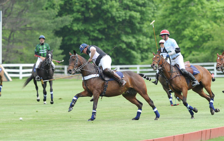 Greenwich resident Peter Orthwein, at center, competes during the Sentebale Royal Salute Polo Cup match at the Greenwich Polo Club, Wednesday, May 15, 2013. The polo match was played to raise funds for Sentebale, a charity Prince Harry co-founded in 2006 in memory of his late mother, Princess Diana. Photo: Bob Luckey / Greenwich Time
