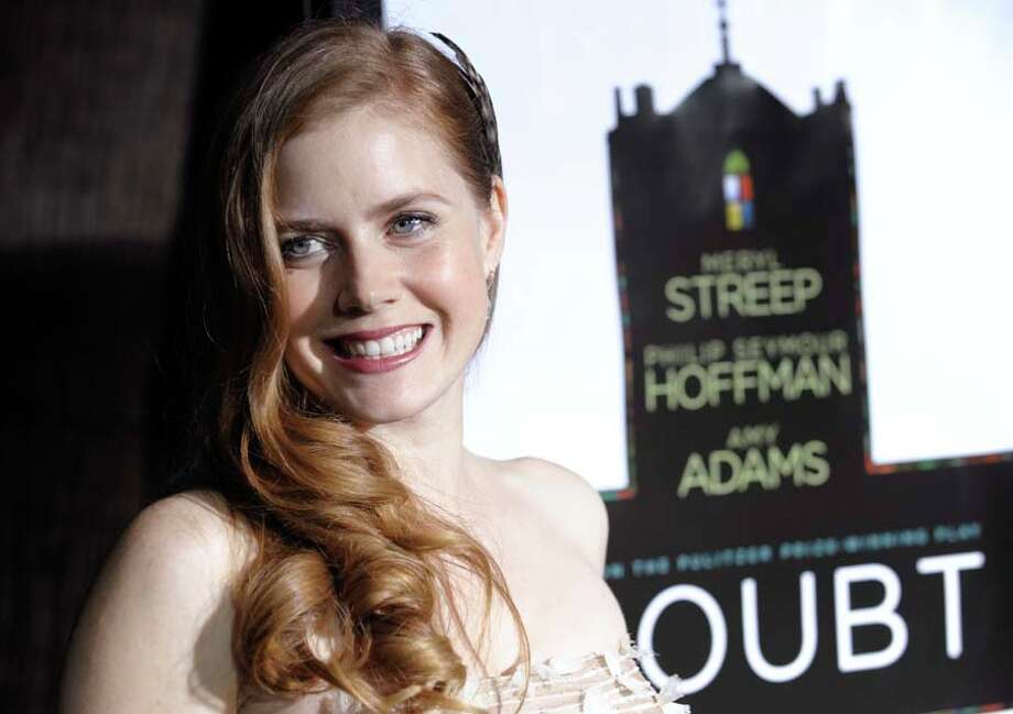Redheaded bombshell Amy Adams could easily be confused for...