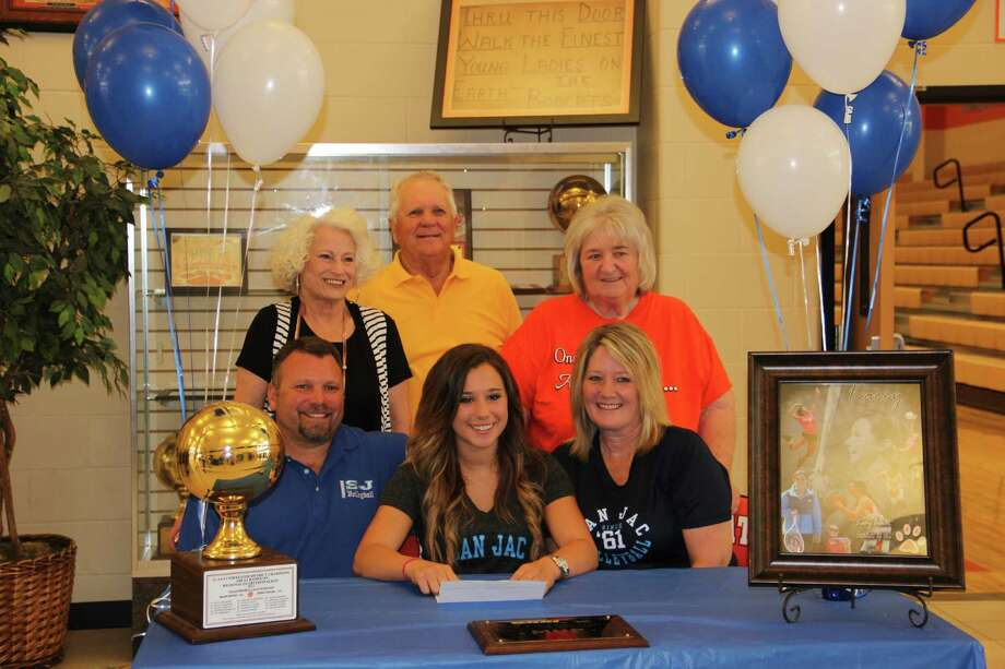 Orangefield volleyball player Kacey LeBlanc signed with San Jacinto College on Wednesday, May 15, 2013. She was surrounded by her family. Photo: Courtesy Of Orangefield HS