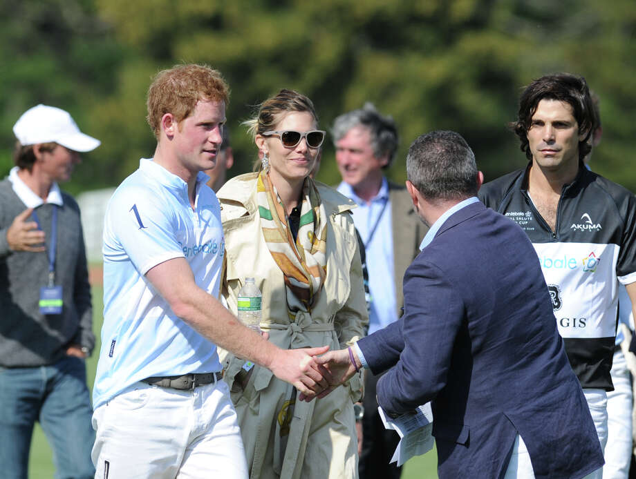 At left, Prince Harry shakes hands during the Sentebale Royal Salute Polo Cup match at the Greenwich Polo Club, Wednesday, May 15, 2013. The polo match was played to raise funds for Sentebale, a charity Prince Harry co-founded in 2006 in memory of his late mother, Princess Diana. Photo: Bob Luckey / Greenwich Time