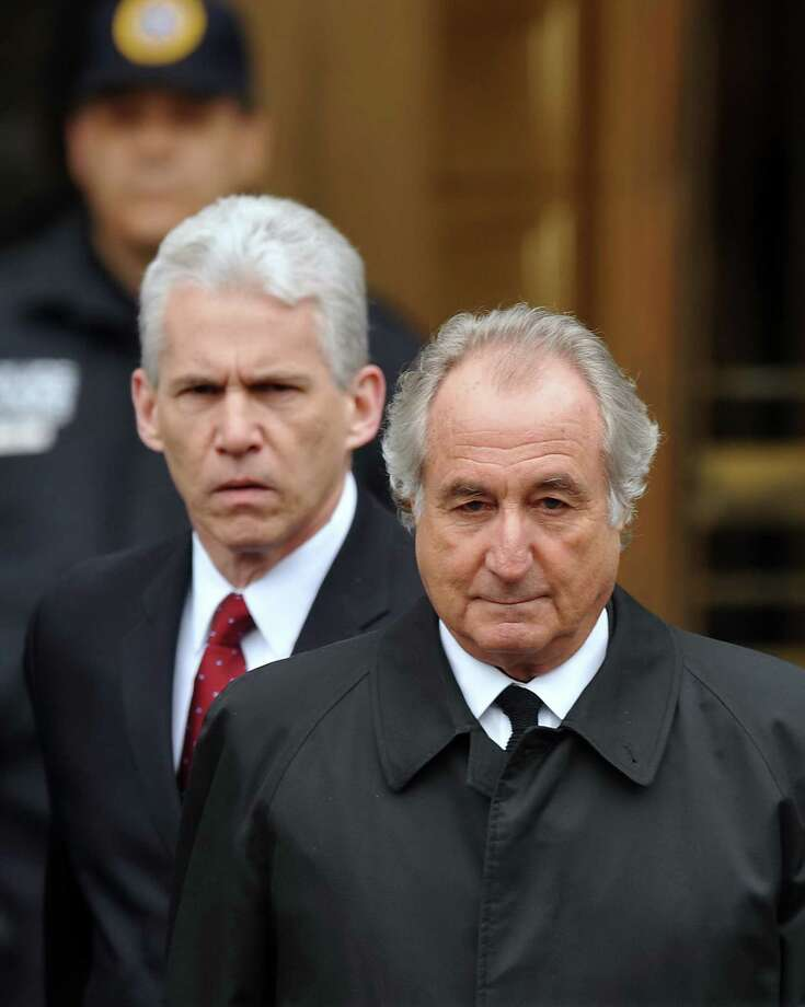 Bernard Madoff leaves Manhattan Federal court after a hearing there Tusday afternoon. The bulletproof vest Bernie Madoff wore under his fine suit could not shield him from barrage of charges, which should ensure he spends rest of his life behind bars for greatest swindle. MADOFF25M Photo: Warga, Craig / New York Daily News