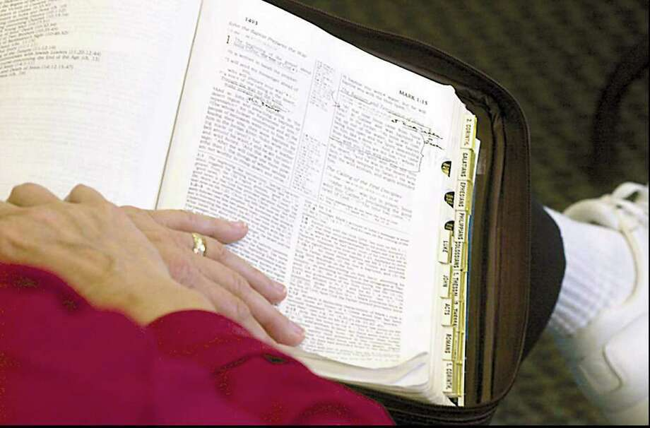 Greenwich resident Debbie Reynolds started the first Greenwich Bible Study group some 28 years ago. Today there are more than 60 such groups. Above, a woman studies the Book of Mark. Photo: File Photo / Greenwich Citizen
