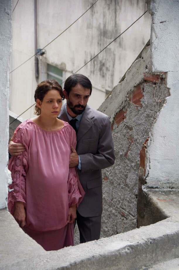 """Éden: Dazed and vulnerable following the sudden death of her husband, heavily pregnant Karine becomes involved in the cultish """"Church of Eden."""" The church's domineering pastor takes her under his wing as a religious ambassador in this sinister and stylish Brazilian drama. North American Premiere (d: Bruno Safadi c: Leandra Leal, João Miguel, Julio Andrade, André Ramiro, Cristina Lago, João Zappa, Brazil 2012, 75 min) Photo: Courtesy Photo"""