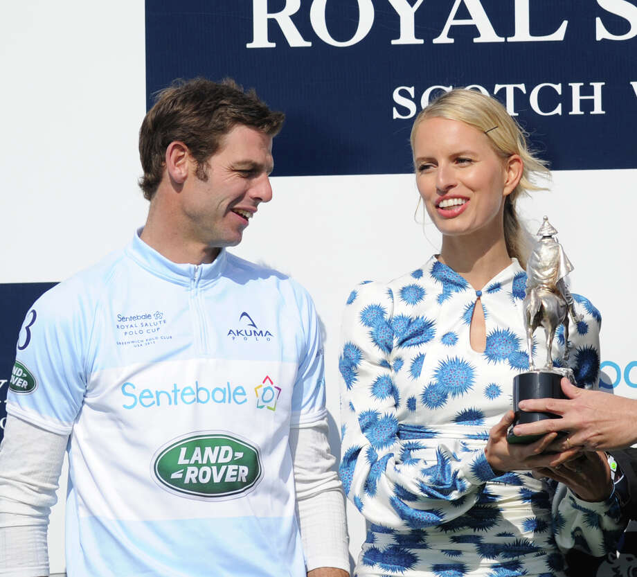 Karolina Kurkova, a model, and Malcolm Borwick, left, of the Sentebale team during the Sentebale Royal Salute Polo Cup match at the Greenwich Polo Club, Wednesday, May 15, 2013. The polo match was played to raise funds for Sentebale, a charity Prince Harry co-founded in 2006 in memory of his late mother, Princess Diana. Photo: Bob Luckey / Greenwich Time