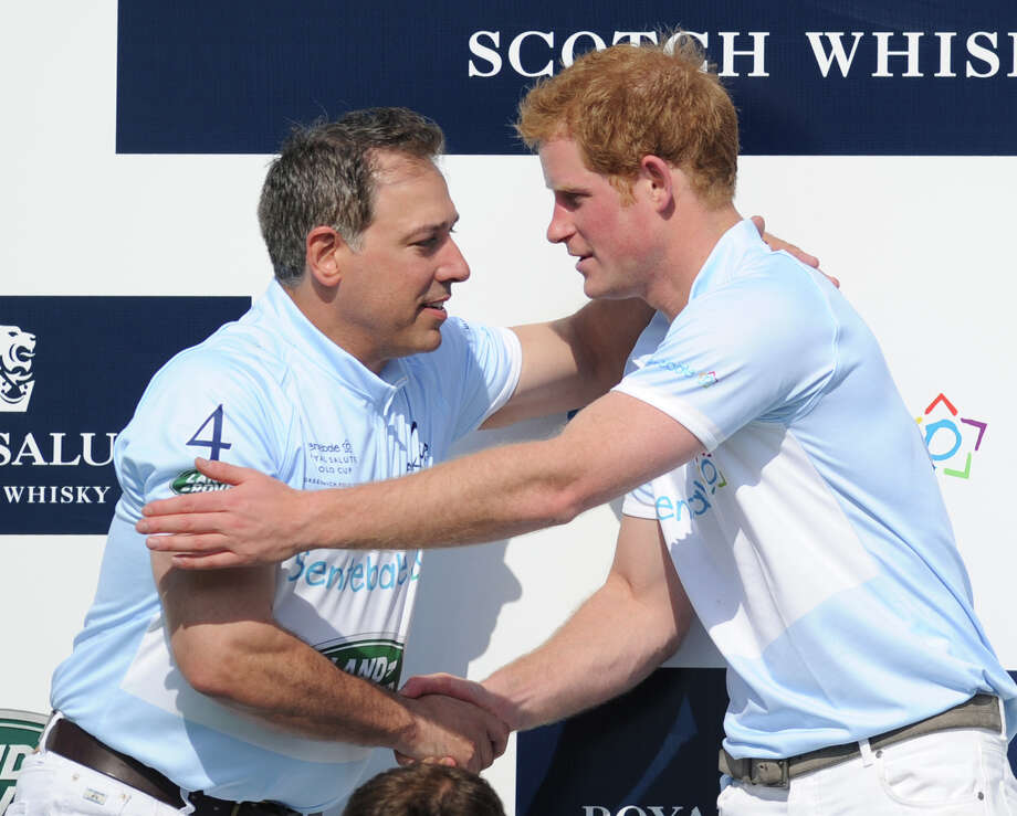 At left, Michael Carrazza of the Sentebale team shakes hands with Prince Harry at the end of the Sentebale Royal Salute Polo Cup match at the Greenwich Polo Club, Wednesday, May 15, 2013. The polo match was played to raise funds for Sentebale, a charity Prince Harry co-founded in 2006 in memory of his late mother, Princess Diana. Photo: Bob Luckey / Greenwich Time