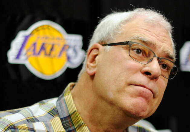 May 11, 2013: ESPN reports that legendary NBA coach Phil Jackson (pictured) is waiting on the league's decision on the Kings before he settles on a new team executive job. Jackson has ''hit it off,'' ESPN reports, with Seattle investor Chris Hansen, leading some to believe he could become president of the Sonics if they return.  Photo: Kevork Djansezian, Getty Images / 2011 Getty Images