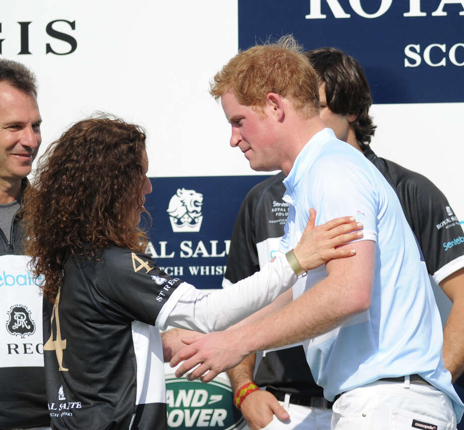 At right, Prince Harry during the Sentebale Royal Salute Polo Cup match at the Greenwich Polo Club, Wednesday, May 15, 2013. The polo match was played to raise funds for Sentebale, a charity Prince Harry co-founded in 2006 in memory of his late mother, Princess Diana. Photo: Bob Luckey / Greenwich Time