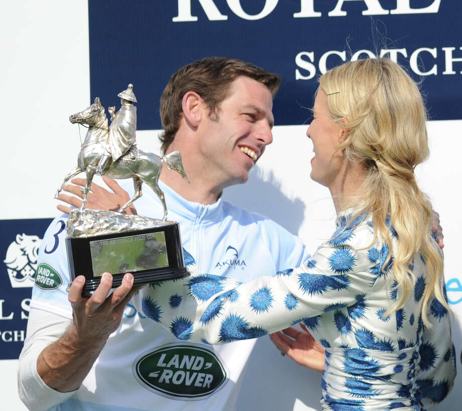Sentebale captain, Malcom Borwick, lefts, gets a hug from Karolina Kurkova, a model, during the Sentebale Royal Salute Polo Cup at the Greenwich Polo Club, Wednesday, May 15, 2013. The polo match was played to raise funds for Sentebale, a charity Prince Harry co-founded in 2006 in memory of his late mother, Princess Diana. Photo: Bob Luckey / Greenwich Time