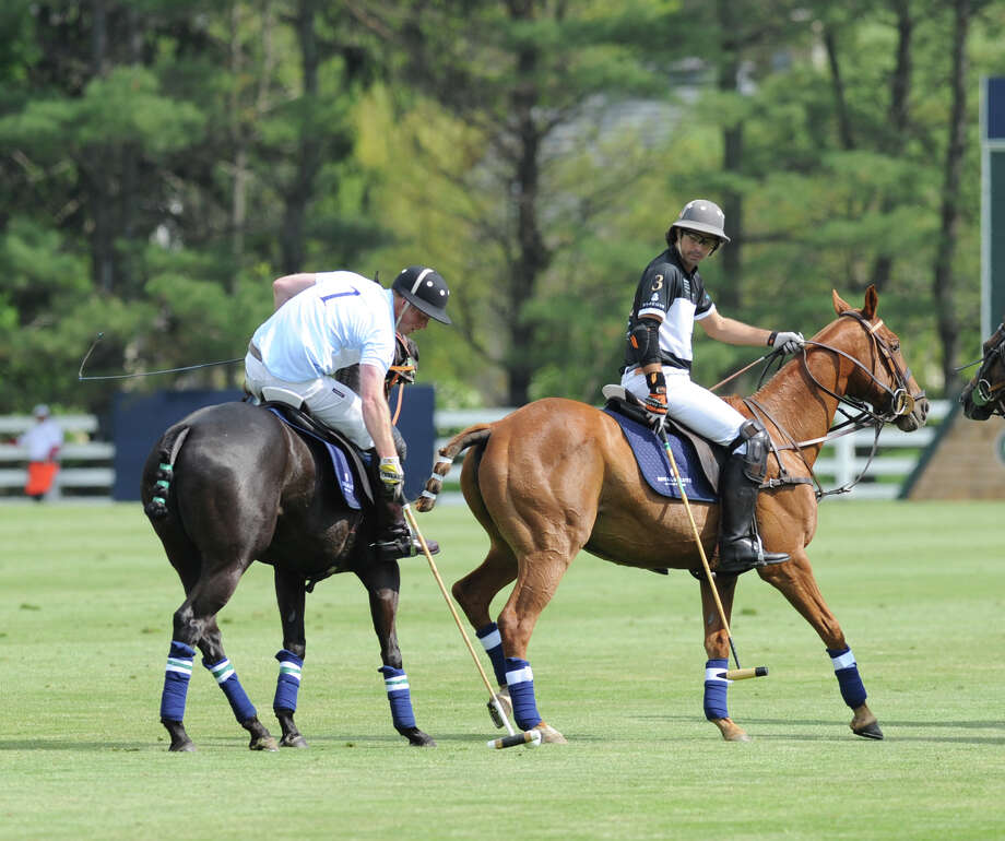 At left, Prince Harry (# 1) during the Sentebale Royal Salute Polo Cup match at the Greenwich Polo Club, Wednesday, May 15, 2013. The polo match was played to raise funds for Sentebale, a charity Prince Harry co-founded in 2006 in memory of his late mother, Princess Diana. Photo: Bob Luckey / Greenwich Time