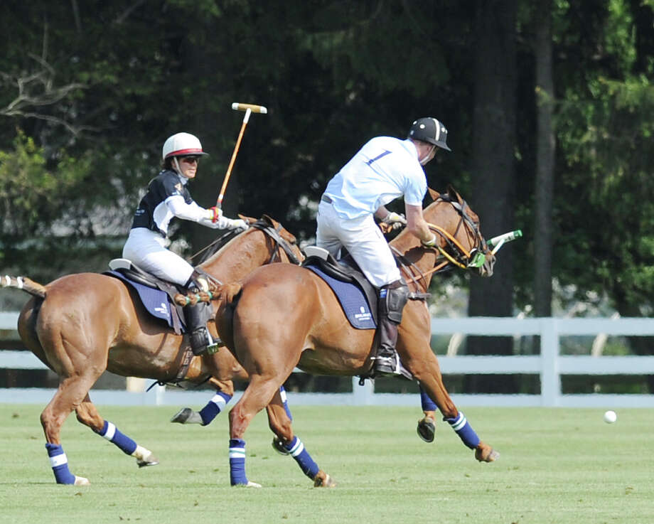 At right, Prince Harry scores the winning goal during the Sentebale Royal Salute Polo Cup match at the Greenwich Polo Club, Wednesday, May 15, 2013. The Prince's team, Sentebale, defeated St. Regis, 4-3. The polo match was played to raise funds for Sentebale, a charity Prince Harry co-founded in 2006 in memory of his late mother, Princess Diana. Photo: Bob Luckey / Greenwich Time