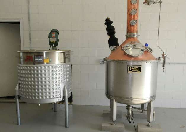 The mash tun, left, and the still at the Lake George Distilling Co. on Tuesday, May 14, 2013 in Fort Ann, N.Y. It's the first legal distillery in Washington County since Prohibition. John McDougall and his wife Robin just got a still and a mash tun installed and are going to be using local grains to make whiskey and vodka. (Lori Van Buren / Times Union) Photo: Lori Van Buren / 00022367A