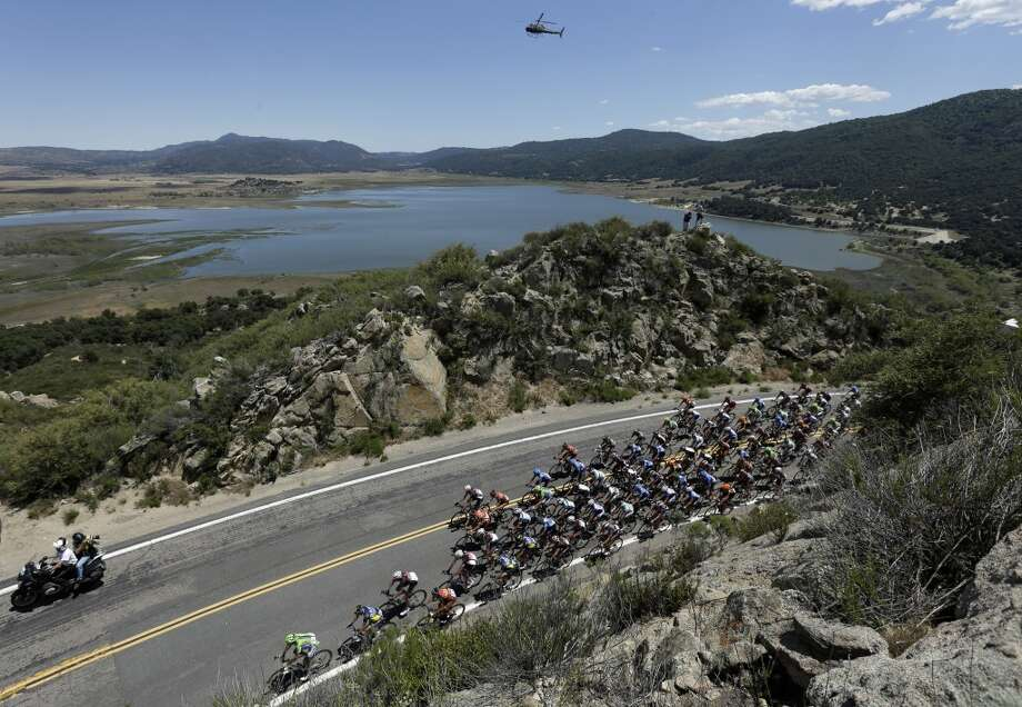 Mauro Da Dalto of Italy, below left, leads the peloton as they climb during the first stage of the Tour of California cycling race over a 102.6 mile loop  Sunday, May 12, 2013, starting and finishing in Escondido, Calif.