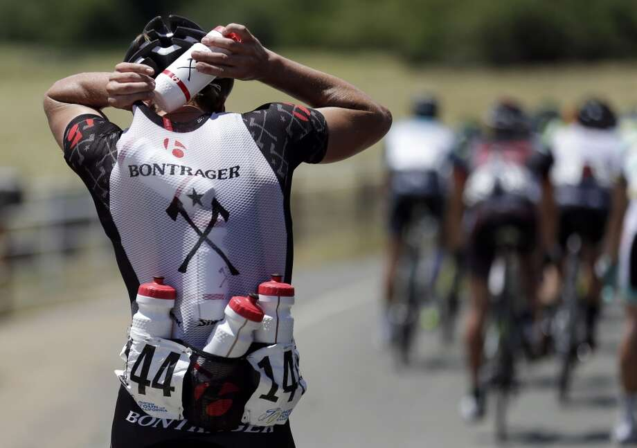 Ryan Eastman stuffs a sixth bottle into his jersey as temperatures hover near 100 degrees during the first stage of the Tour of California cycling race over a 102.6 mile (165.12 kilometers) loop Sunday, May 12, 2013, starting and finishing in Escondido, Calif.