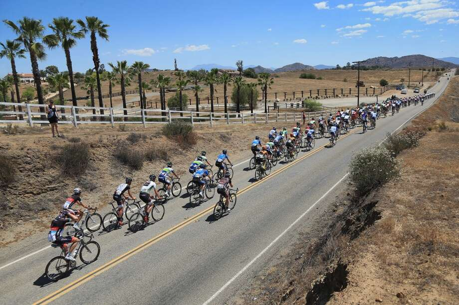 The peloton passes through the countryside during Stage Two of the 2013 Amgen Tour of California from Murrieta to Palm Springs on May 13, 2013 in Murrieta, California.
