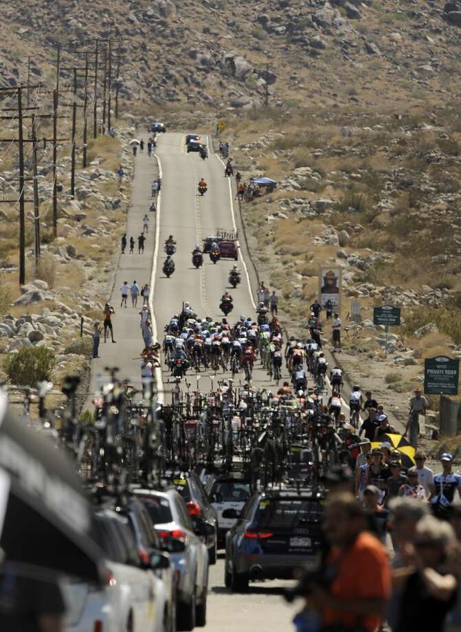 The peloton makes its way up the steep Tram Way road in Palm Springs, Calif., during the Amgen Tour of California Bike Race on Monday, May 13, 2013. This was Stage 2 of the race which started in Murrieta, Calif., and finished in Palm Springs, Calif.