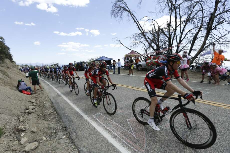 Brent Brookwater, right, leads BMC teammates Amael Moinard of France, second from right, Tejay van Garderen, third from right, and Mathias Frank of Switzerland, fourth from right, during the first stage of the Tour of California cycling race over a 102.6 mile (165.12 kilometers) loop  Sunday, May 12, 2013, starting and finishing in Escondido, Calif.