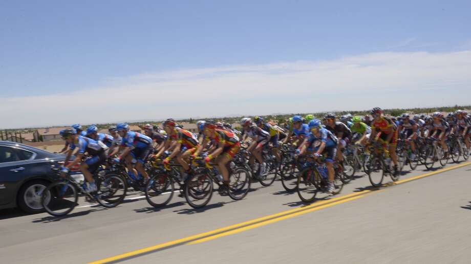 Riders make their way through Palmdale, Calif., during the third stage of the Tour of California cycling race, Tuesday, May 14, 2013.