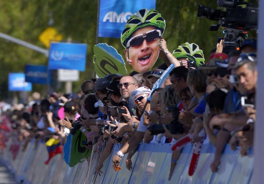 Fans hold up pictures of Peter Sagan, of Slovakia, during the third stage of the Tour of California cycling race, Tuesday, May 14, 2013, in Santa Clarita, Calif.
