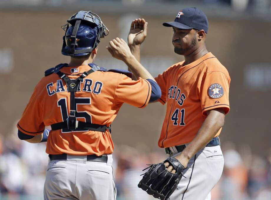 Astros relief pitcher Jose Veras celebrates the win over the win with catcher Jason Castro.