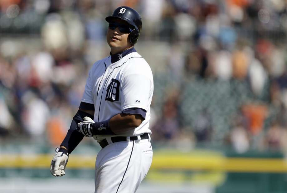 Miguel Cabrera walks back to the dugout after flying out with the bases loaded to end the game.
