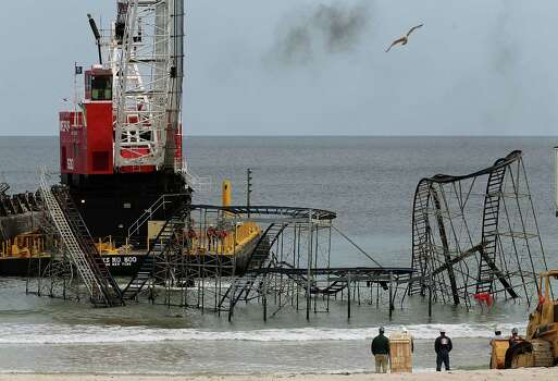 A large crane demolishes the JetStar roller coaster that has been in the ocean for six months after the Casino Pier is sat on collapsed when Superstorm Sandy hit, May 14, 2013 in Seaside Heights, New Jersey. Photo: Mark Wilson, Getty Images / 2013 Getty Images
