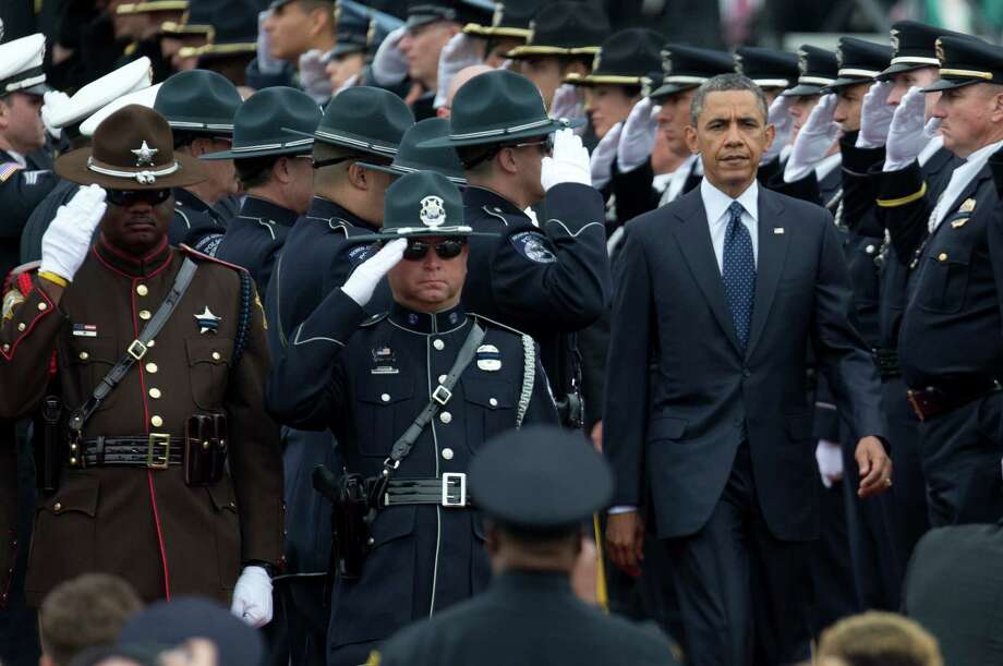 Law enforcement officers salute as President Barack Obama arrives at the 32nd annual National Peace Officers' Memorial Service, Wednesday in Washington. Photo: Carolyn Kaster, STF / AP