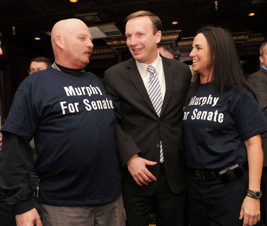 Ray Soucy, left, of AFSCME Local 391, the corrections officers union, with Congressman Chris Murphy and Lisamarie Fantano of East Hampton, after Murphy announced his intention to run for the senate on Thursday, Jan. 20, 2011. Soucy told Dan Malloy he had not showed sufficient respect to his union members drawing a salty retort from the governor. Photo: Carol Kaliff / The News-Times