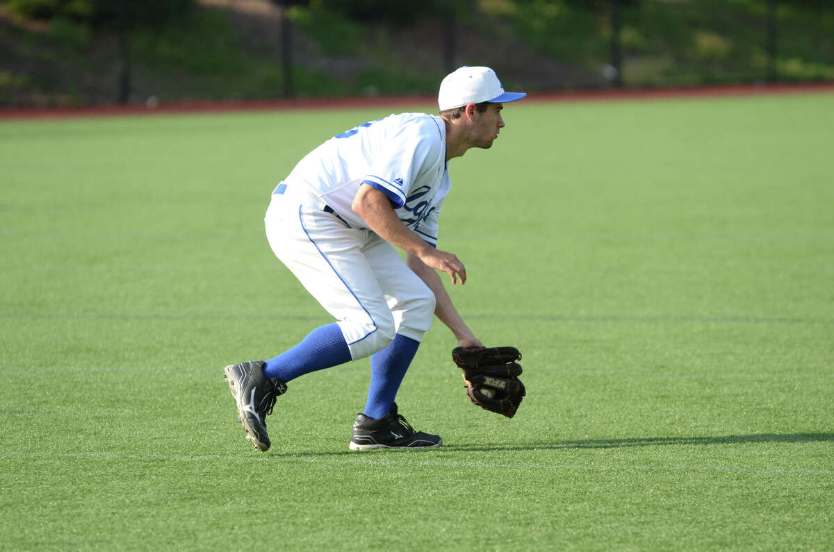 Darien's Cameron Smith (29) fields a ball hit to the outfield during the baseball game against Wilton at Darien High School on Wednesday, May 15, 2013.
