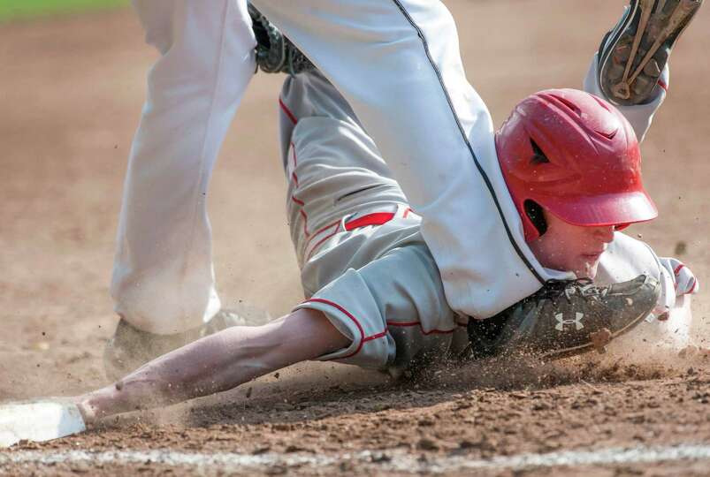 Greenwich high school's, Patrick Santini, is tagged out by New Canaan high school third baseman,