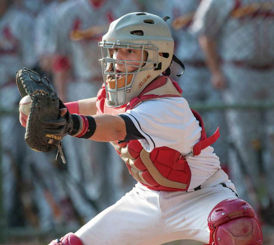 New Canaan high school catcher, Casey Ouellette, doesn't get the throw in time as Greenwich high school's, Zachary Monick, slides safely into home during a baseball game played at Mead Memorial Park, New Canaan, CT on Wednesday May 15th, 2013. Photo: Mark Conrad / Stamford Advocate Freelance