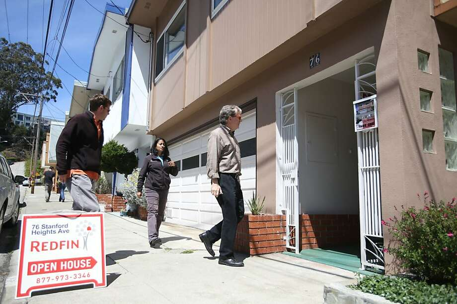 Achim Albrecht (left), Mamata Kene and Whitney Davis attend an open house on Stanford Heights Avenue in San Francisco. Tight inventory in the Bay Area is pushing home prices up. Photo: Mathew Sumner, Special To The Chronicle