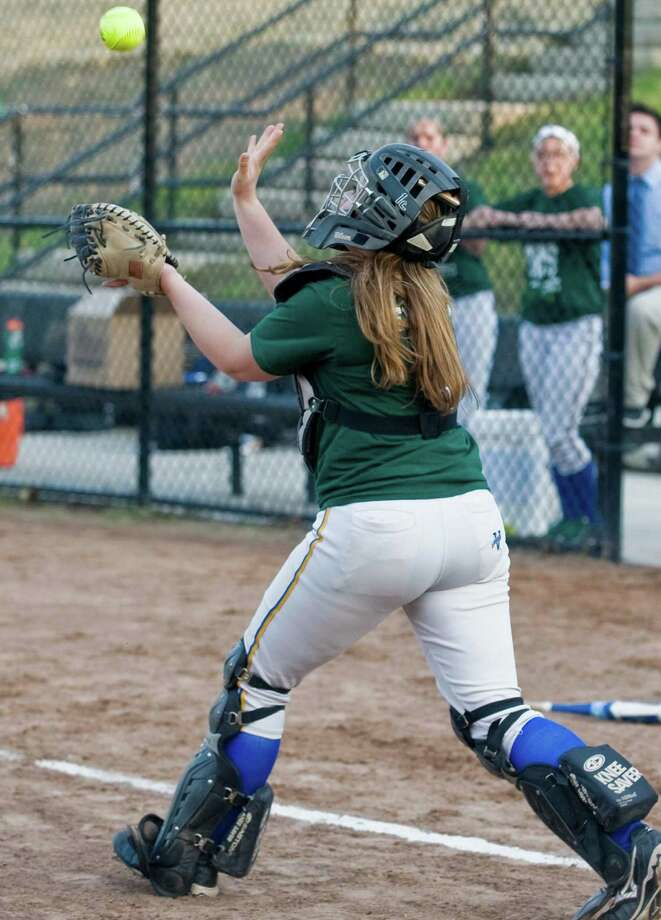 Newtown High School catcher Emily Woznick tries to catch a pop-up in the Sandy Hook Memorial softball game against Brookfield High School, played at Treadwell Park in Newtown. Wednesday, May 15, 2013 Photo: Scott Mullin / The News-Times Freelance