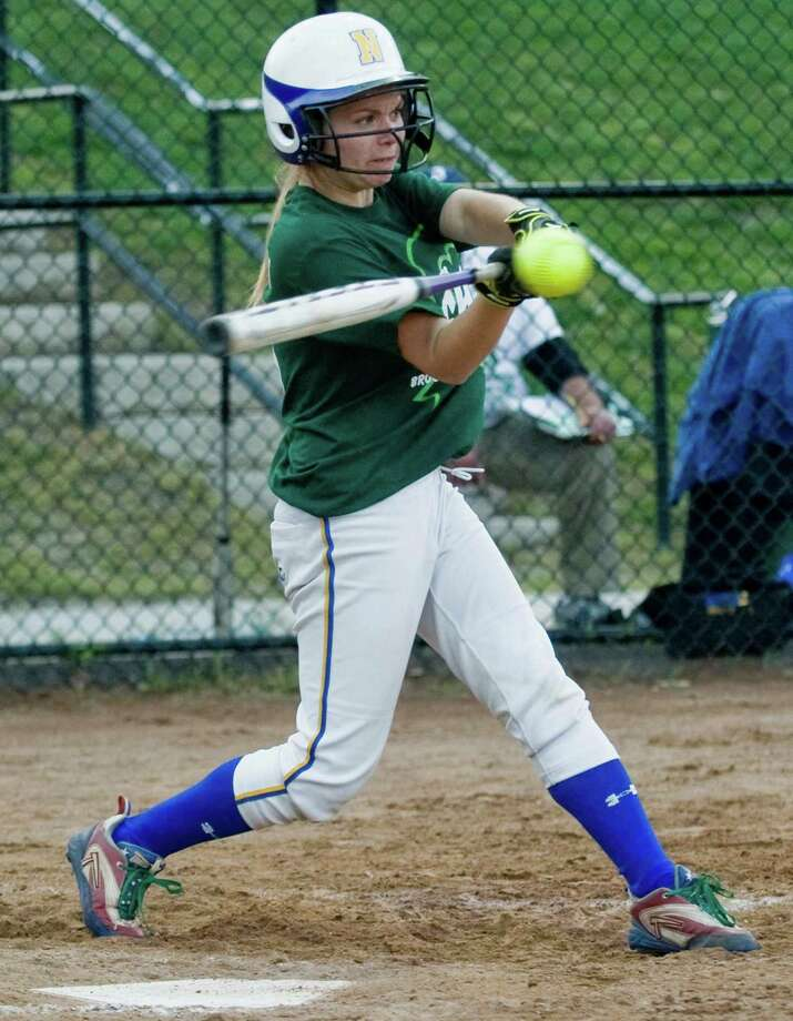 Newtown High School batter Courtney Escoda swings at a pitch during the Sandy Hook Memorial softball game against Brookfield High School, played at Treadwell Park in Newtown. Wednesday, May 15, 2013 Photo: Scott Mullin / The News-Times Freelance