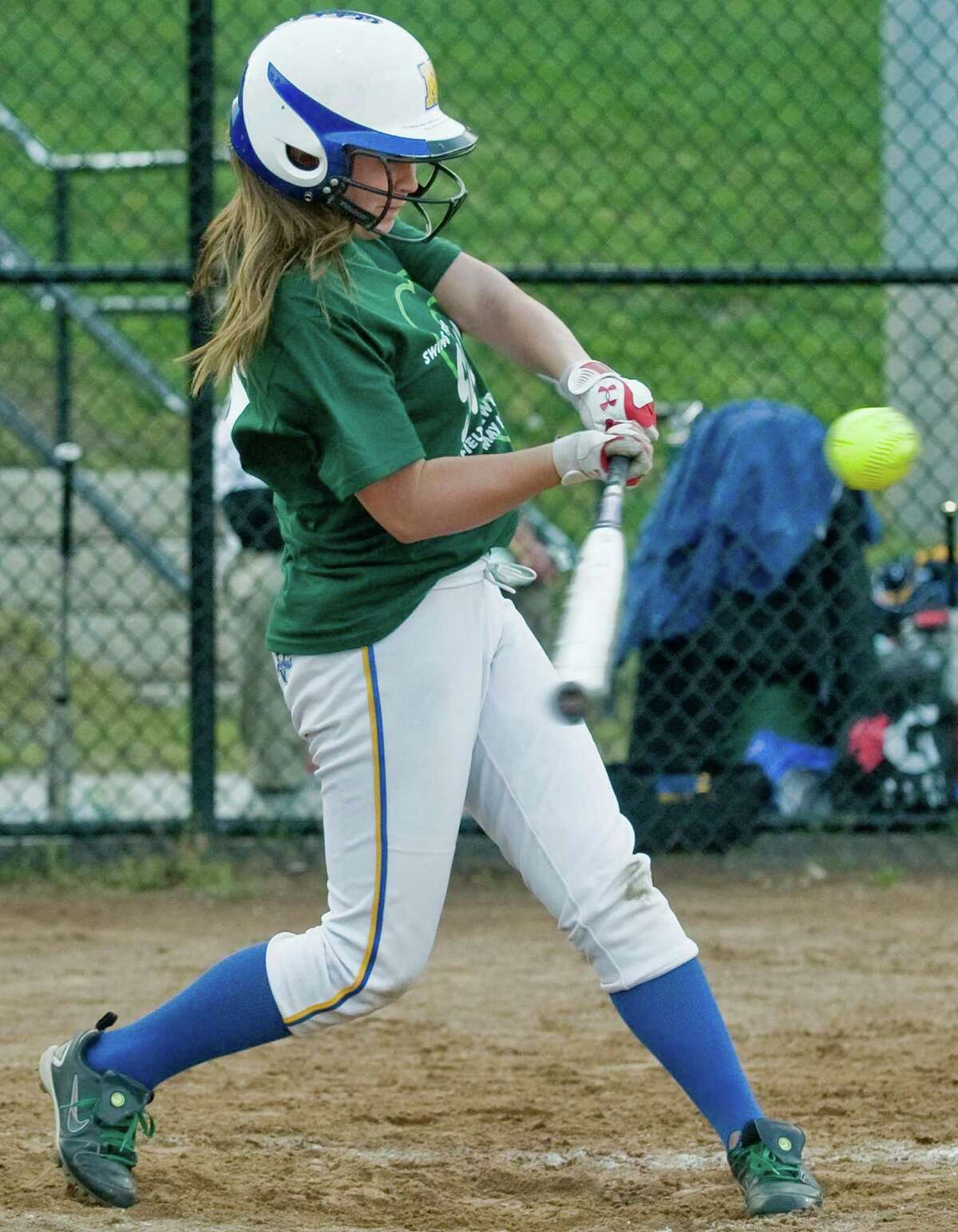 Newtown High School batter Katie Laaksonen swings at a pitch during the Sandy Hook Memorial softball game against Brookfield High School, played at Treadwell Park in Newtown. Wednesday, May 15, 2013