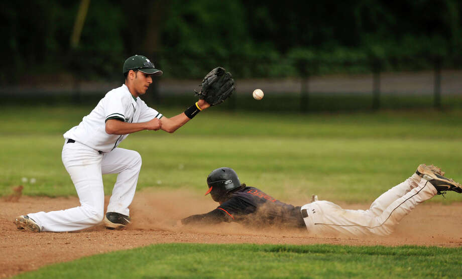 Stamford's Travis Docimo steals second base beating the tag of Norwalk shortstop Tyler Annunziata during their game at Eric Malmquist Field in Norwalk on Wednesday, May 15, 2013. Stamford won, 7-2. Photo: Jason Rearick / Stamford Advocate