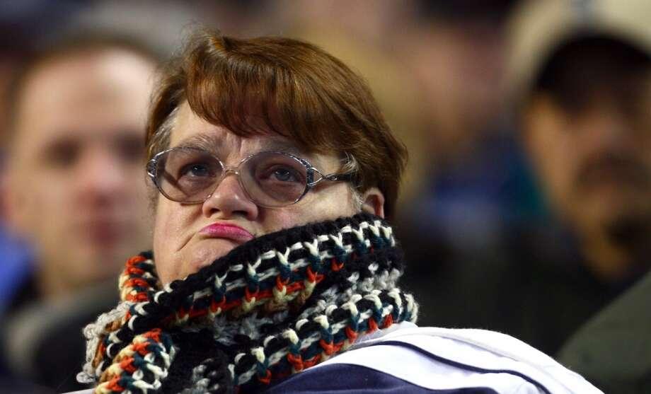 Baseball fan watching the Mariners.