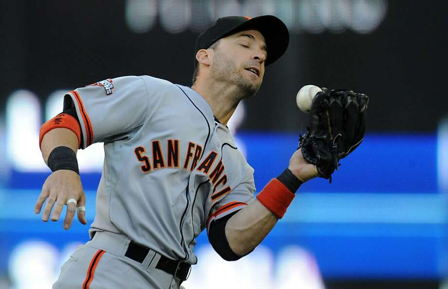 San Francisco Giants second baseman Marco Scutaro drops a ball on Toronto Blue Jays' Jose Bautista's hit during first-inning AL baseball game action in Toronto, Wednesday, May 15, 2013.  (AP Photo/The Canadian Press, Frank Gunn) Photo: Frank Gunn, Associated Press