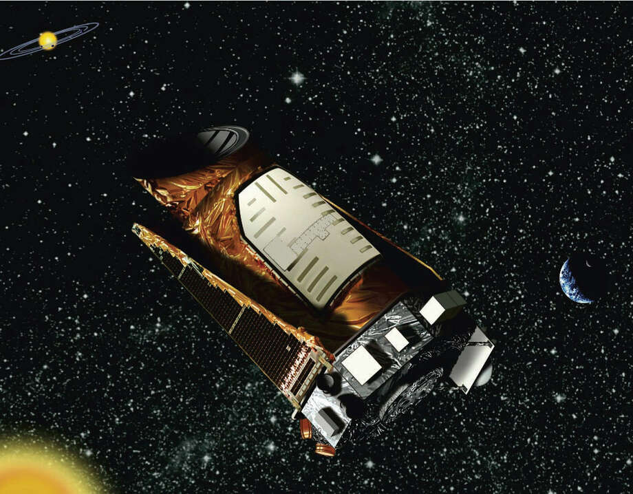 This file artist's rendering provided by NASA shows the Kepler space telescope. The spacecraft lost the second of four wheels that control the telescope's orientation, NASA said Wednesday. If engineers can't find a fix, the failure means Kepler won't be able to look for more planets outside our solar system. Photo: NASA Illustration / Associated Press