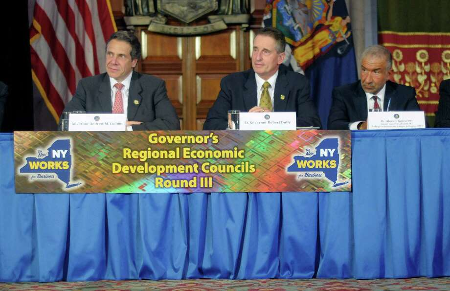 Governor Andrew Cuomo, left, Lt. Governor Bob Duffy, center, and Alain Kaloyeros, senior vice president and CEO of the College of Nanoscale Science and Engineering, take part in a meeting of the Regional Economic Development Councils at the Capitol on Wednesday, May 15, 2013 in Albany, NY.  The State is kicking off round three of the state-wide competition for State funds.   (Paul Buckowski / Times Union) Photo: Paul Buckowski