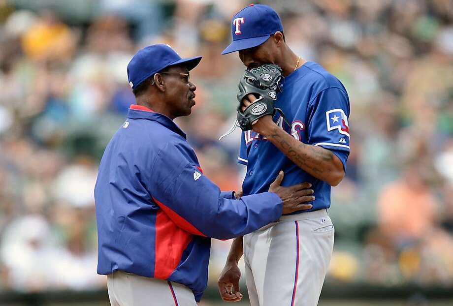 OAKLAND, CA - MAY 15:  Manager Ron Washington #38 of the Texas Rangers comes out to the mound to talk with pitcher Alexi Ogando #41 against the Oakland Athletics in the six inning at O.co Coliseum on May 15, 2013 in Oakland, California.  (Photo by Thearon W. Henderson/Getty Images) Photo: Thearon W. Henderson, Getty Images