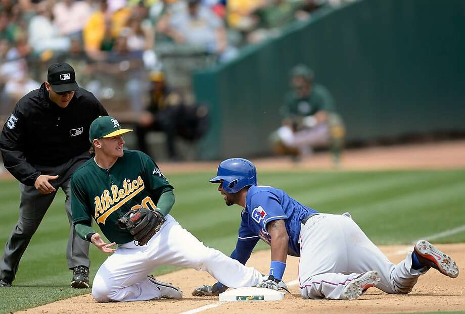 OAKLAND, CA - MAY 15:  Elvis Andrus #1 of the Texas Rangers steals third base, beating the throw to Josh Donaldson #20 of the Oakland Athletics in the fifth inning at O.co Coliseum on May 15, 2013 in Oakland, California.  (Photo by Thearon W. Henderson/Getty Images) Photo: Thearon W. Henderson, Getty Images