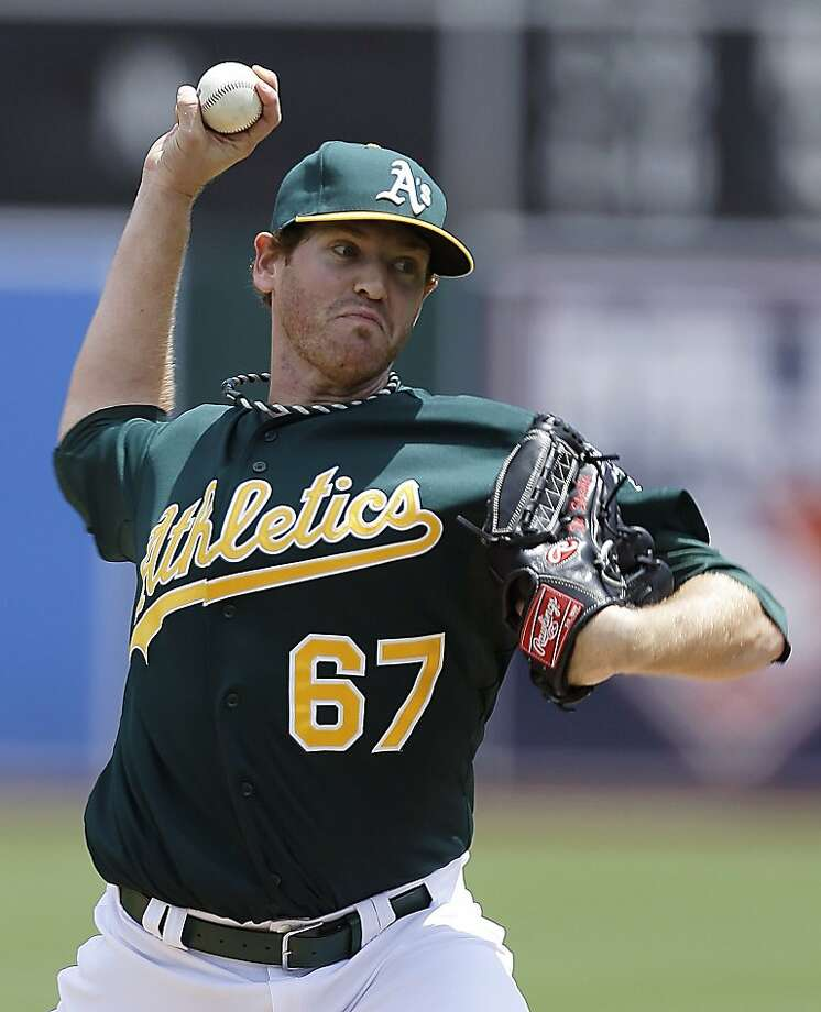 Oakland Athletics' Dan Straily works against the Texas Rangers in the first inning of a baseball game Wednesday, May 15, 2013, in Oakland, Calif. (AP Photo/Ben Margot) Photo: Ben Margot, Associated Press