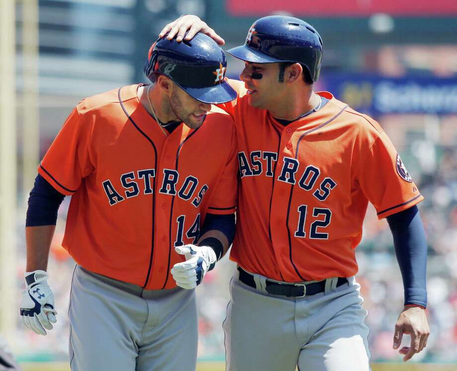 J.D. Martinez #14 of the Houston Astros is congratulated by Carlos Pena #12 after hitting a three-run home run against the Detroit Tigers in the fourth inning at Comerica Park on May 15, 2013 in Detroit, Michigan. Photo: Duane Burleson, Stringer / 2013 Getty Images